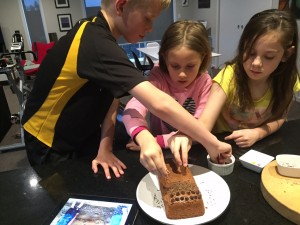 Adding the different layers/toppings to the cake.